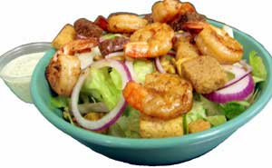 Romaine salad served with pepitas, red onions, croutons, garlic cilantro dressing and shrimp